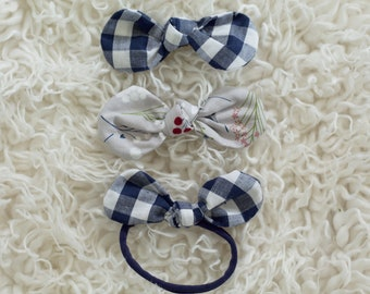 Made to match fabric bow on alligator clip or nylon band.