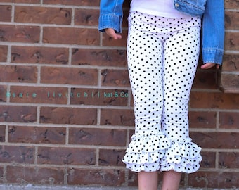 Only a few sizes left, 18 months, 3, 6 and 10!  Black and white polka dot  triple ruffled capri leggings