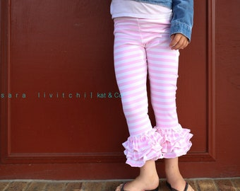 Size 10, last pair.  Ships free.  Ruffled capri leggings in pink and white stripe knit.