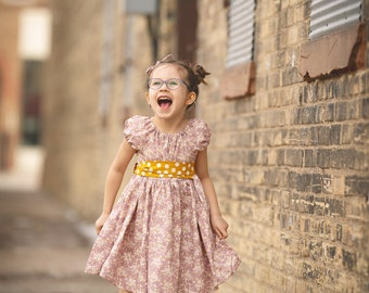 Girls lilac floral dress with sash.  Custom made sizes 12 months to 12 years.