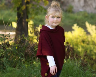 Girls cowl necked poncho.   Available girls 12 months  to 12 years.