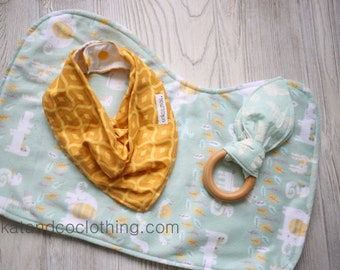 Clearance. Ships free.  Baby gift:  contoured burpcloth, teether and bib.    Free shipping.