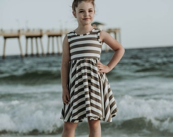 Girls knit ballerina inspired striped dress .     Available girls 12 months to 10 years.