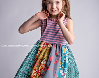 Girls dress in gray, teal, citron and pink .     Available girls 6 months to 12 years.