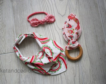 Clearance. Ships free.  Baby gift:  headband, teether and bib.    Free shipping.