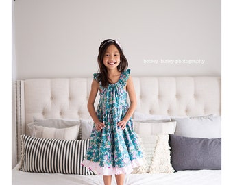Girls flutter sleeve sundress with ruffled underlay.   Custom made sizes 12 months to 12 years.