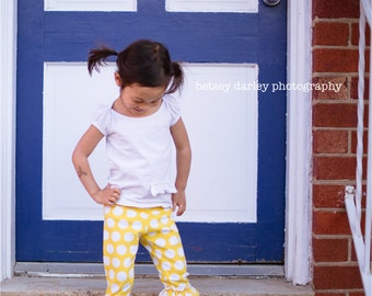 Size 12, free shipping.  Yellow and white polka dot ruffled capri leggings.