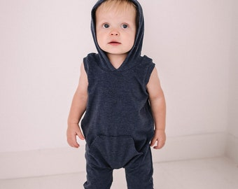 Super soft hooded tank style pocket romper. Snap-less, soft cotton. Custom made 0 to 4t in many different colors.
