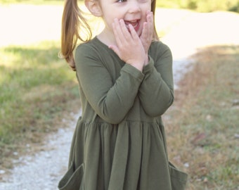 Girls long sleeve pocket knit dress.  Custom order in many colors.   Available girls 12 months  to 12 years.