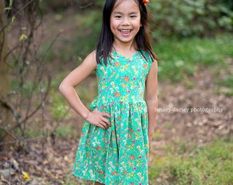 Girls knit ballerina inspired green floral dress . Free US shipping.    Available girls 12 months to 10 years.