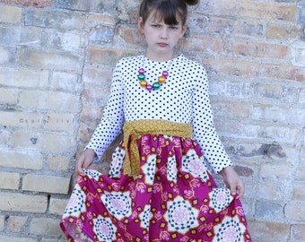 "Limited availability.  Girls  ""beautiful mosaic""  dress .     Available girls 6 months to 10 years."