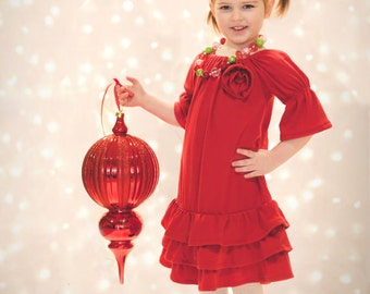 Girls ruffled dress.  You choose color.   Available girls 12 months to 12 years.