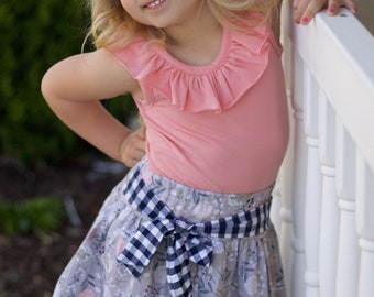 Girls skirt with sash.  Elastic waist, super full.  Custom made sizes 12 months to 12 years.