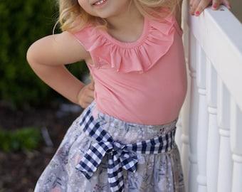 Girls skirt with sash.  Elastic waist, super full.  Custom made sizes 12 months to 12 years.