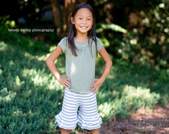 Double ruffle shorts in gray and white stripe, other prints available.    Available girls 12 months to 10 years.