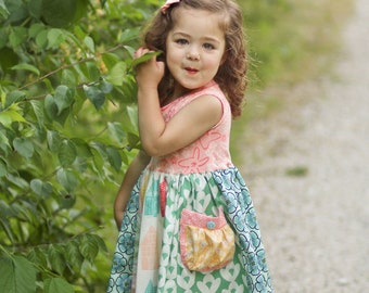 Girls tank style dress with full skirt and pocket.
