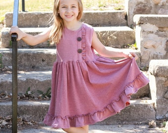Girls tank style knit dress with ruffled bodice detail.  Custom colors and sizes.
