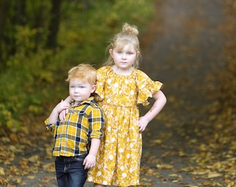 Girls mustard floral ruffled dress.    Custom made sizes 12 months to 12 years.