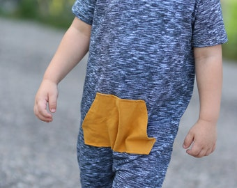 Super soft short sleeve pocket romper. Snap-less, soft cotton.
