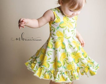 Girls knit ballerina inspired lemon dress .     Available girls 12 months to 10 years.