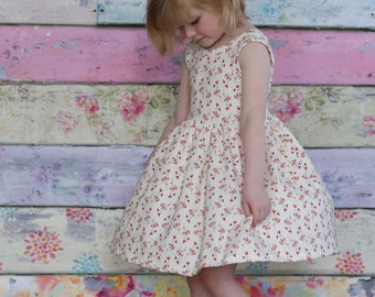 Girls knit ballerina inspired floral dress .     Available girls 12 months to 10 years.