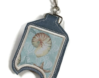 Cork hand sanitizer holder with clip. Blue shell fabric sanitizer holder.