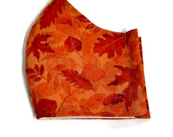 Cotton face mask with orange fall leaves