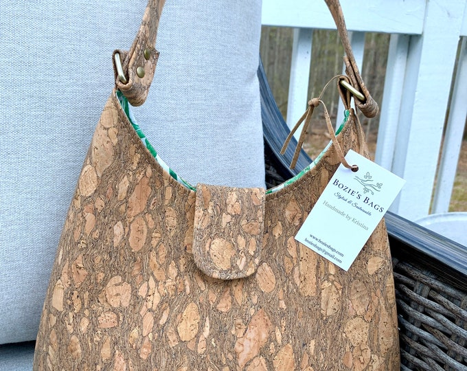 Featured listing image: Textured cork sling purse with green leaf liner fabric.
