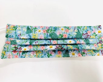 Pleated mask in light blue floral fabric