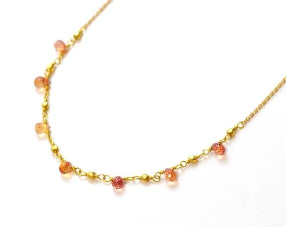 18K Gold. Orange Sapphire necklace