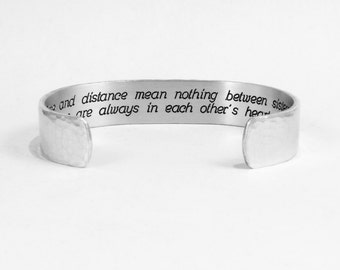 "Sister Gift - Time and distance mean nothing between sisters, we are always in each other's hearts"" 1/2"" hidden message cuff bracelet"