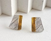 Silver and yellow gold ea...