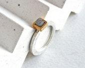 Raw diamond engagement ri...