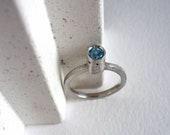 Skye blue topaz ring, geo...