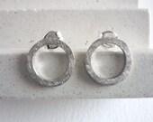 Small silver hoop earring...