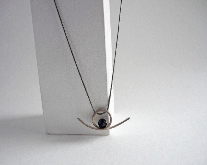 Mini sculptural curl pendant silver and black onyx loop image 0