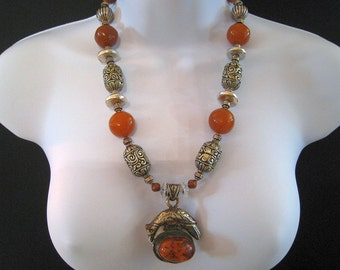 Tibetan Bead Necklace With Bird Pendant, Silver Repousse Barrel Beads, And Amber Colored Lucite, Statement Sized #796