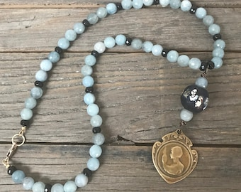 Vintage repurposed one of a kind blue aquamarine gemstone and black glass bead old female medal pendant necklace
