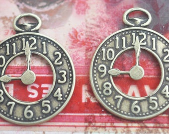 FOUR Steampunk brass clock charms, brass ox, Brass Charms, Stampings