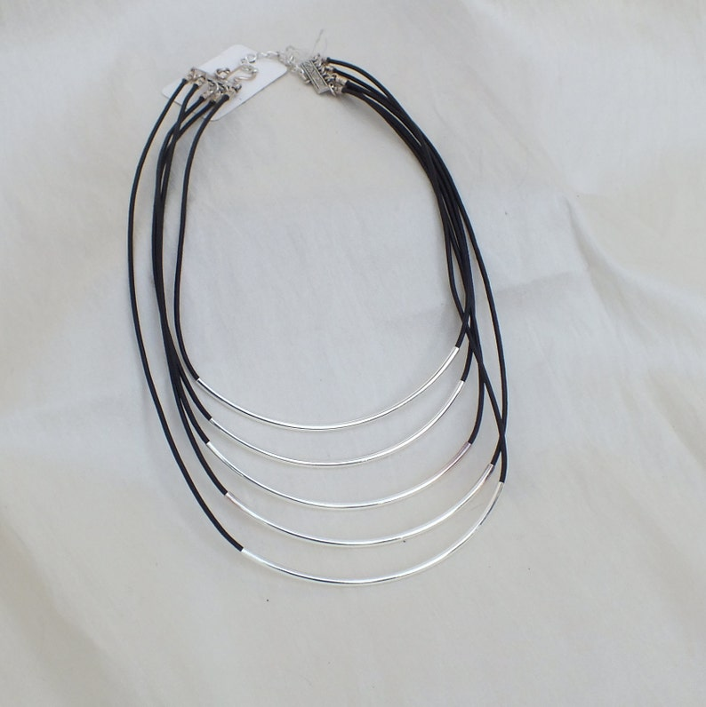 Multi strand leather and silver tube necklace