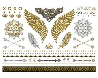 Designer temporary metallic tattoos in gold, silver and black. tattoos - flash - body art, tatoo, jewelry, wings, mandalas, diamonds, arrows