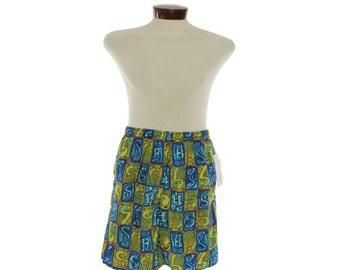 Cute Iil 1960s tiki style swim trunks!