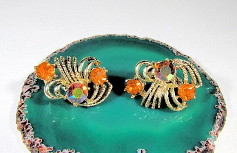 Vintage Coro Pegasus Goldtone and Orange Citrine Glass Round Rhinestone Textured Clip On Earrings