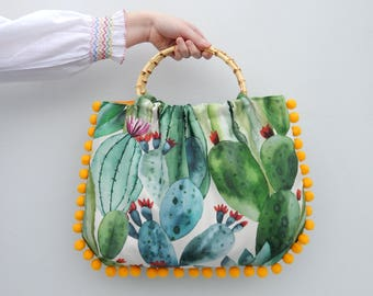 Blooming cactus 50s style handbag with bamboo handles and pom pom trim,