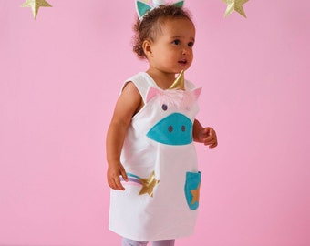 Unicorn character pinafore dress in aqua cord by Wild Things