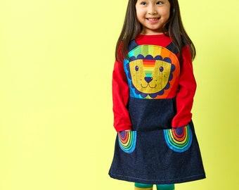 Rainbow lion pinafore dress