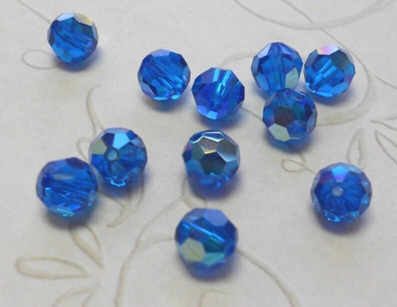 d08aeccc2 Capri blue ab Swarovski art 5000 6mm beads x12   Etsy