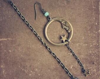 moonlight.  a pair of moon and star assymetrcial brass earrings.
