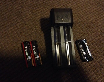 2 lithium batteries AND charger