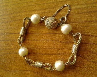 Delicate faux pearl and goldtone metal rope bracelet